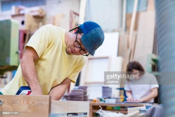 Furniture designers working in their workshop