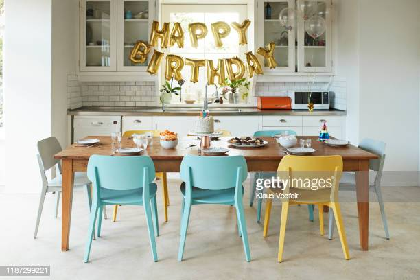 furniture in kitchen during birthday party - happy birthday stock pictures, royalty-free photos & images