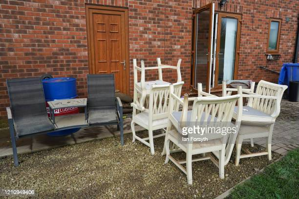 Furniture is stacked outside a house as residents in the Yorkshire village of East Cowick assess the damage to their homes as flood waters finally...
