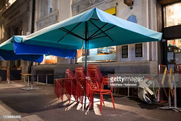 Furniture outside a restaurant St. Mary Street on September 24, 2020 in Cardiff, Wales. Pubs, cafes and restaurants in Wales will have to shut at...