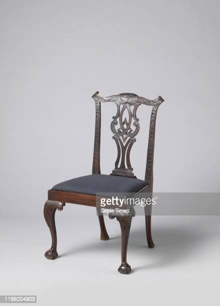 Furniture Six mahogany chairs with leather seats The Sshaped forelegs placed at an angle end in claw and ball and carry leafwork on the swellings...