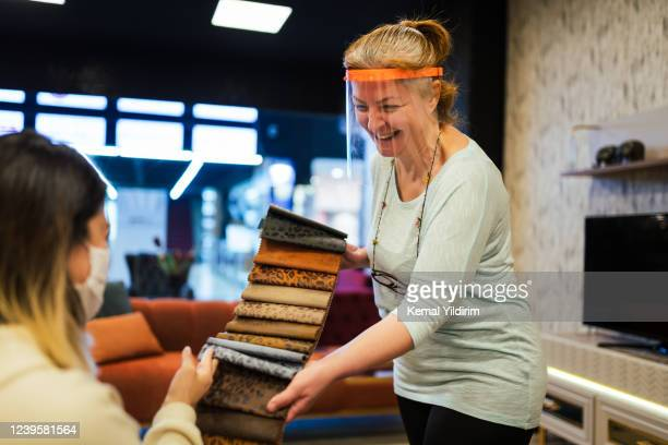 furniture store owner happy for reopening her store after quarantine - assistant stock pictures, royalty-free photos & images