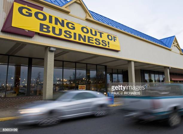 A furniture store posts a 'Going Out of Business' sign in a residential strip mall November 11 in Manassas Virginia US Presidentelect Barack Obama...