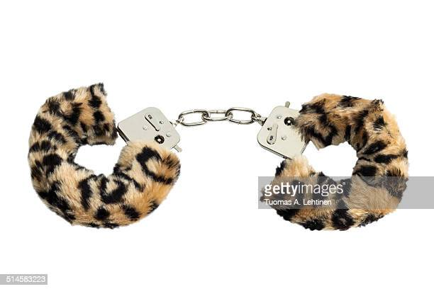 furry and metal sex toy handcuffs - sex toy stock photos and pictures