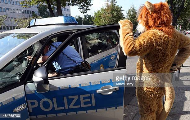 Furry enthusiast sits in a police car at the Eurofurence 2015 conference on August 21 2015 in Berlin Germany Furry fandom a term used in zines as...