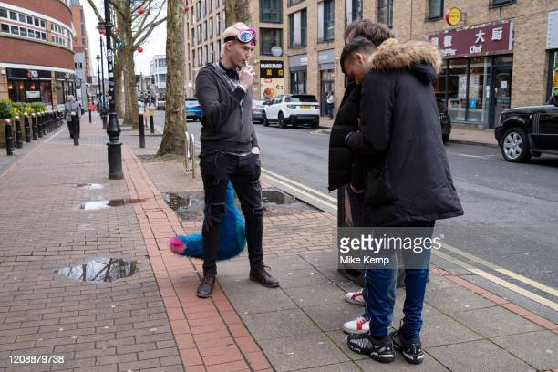 Furry without his head on vaping outside a bar on 14th March 2020 in Birmingham United Kingdom The furries fandom is a subculture interested in...
