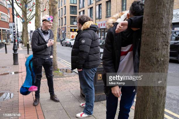 Furry without his head on vaping outside a bar on 14th March 2020 in Birmingham, United Kingdom. The furries fandom is a subculture interested in...