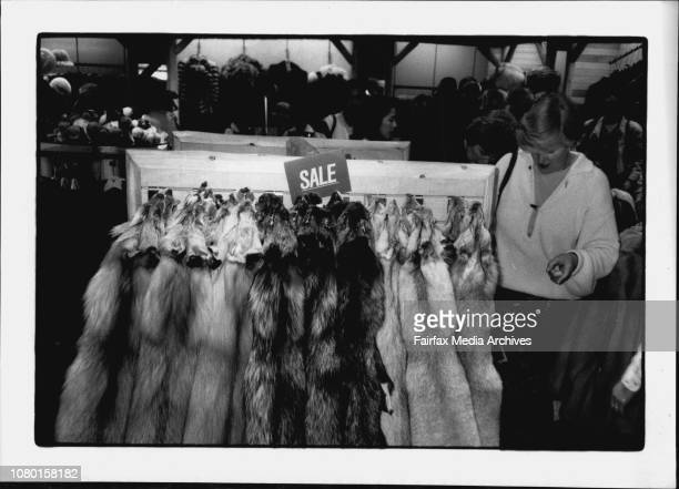 Furs The fur trade in full swing Shoppers peruse furs for sale at the Anchorage Airport in Alaska June 01 1990