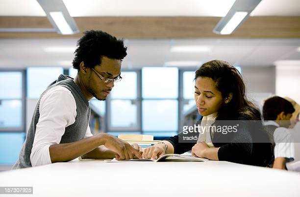 further education: a pair of college students working together