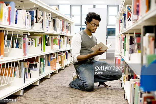 further education: a solitary student using his college library