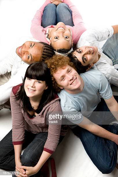 further education: diverse circle of carefree smiling friends looking up - class photo stock photos and pictures