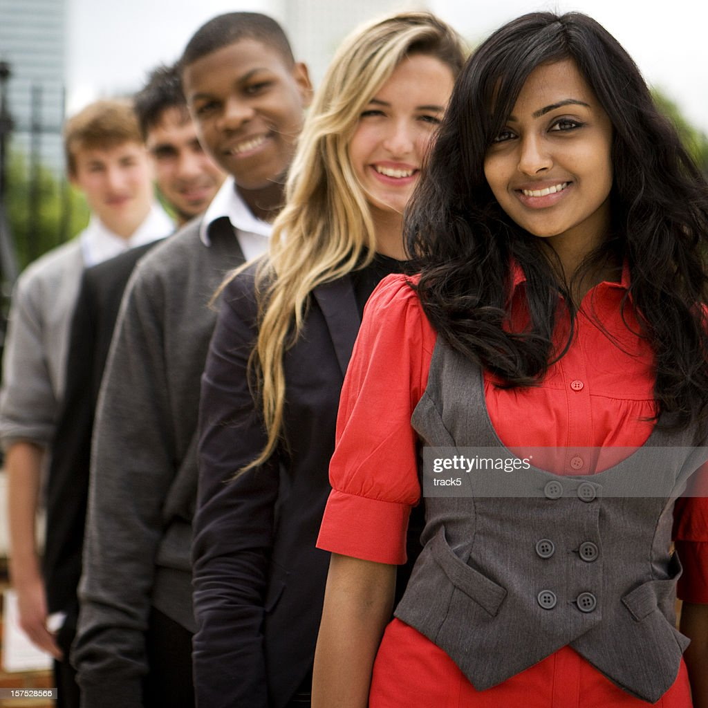 further education: teenagers standing in a row : Stock Photo
