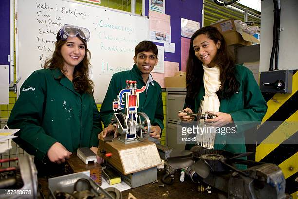 further education: trainee mechanics smiling as they learn their trade - education building stock pictures, royalty-free photos & images