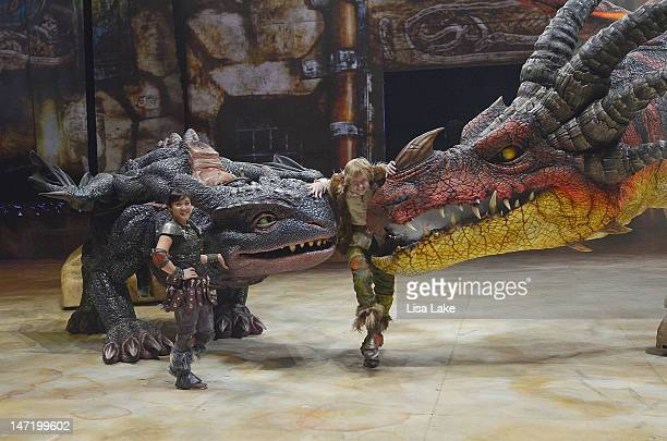 """Fury dragon """"Toothless"""", Gemma Nguyen as """"Astrid"""", Riley Miner as """"Hiccup"""" and monstous dragon """"Nightmare"""" pose during a preview of DreamWorks' """"How..."""