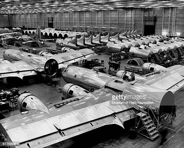 Fuselages and tailpieces for the B-29 bomber cover the floor of the Boeing Plant in Renton, Washington, August 16, 1944. | Location: Boeing factory,...