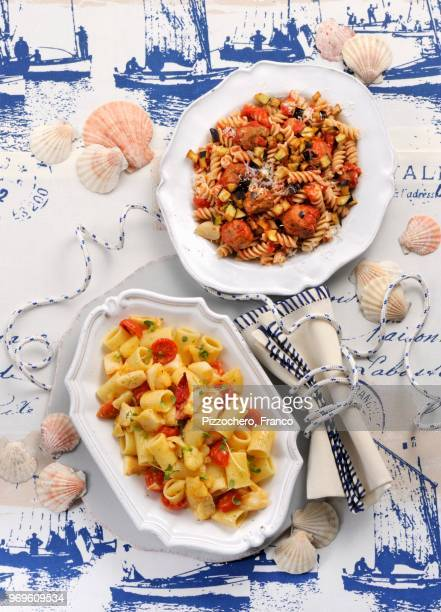 fusilli with meat dumplings and aubergines, and pasta with potatoes and stock fish - food state stock pictures, royalty-free photos & images