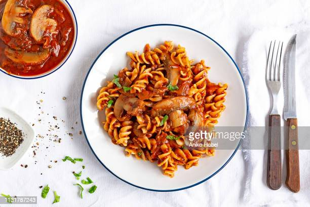 fusilli with tomato sauce and mushrooms - pasta stock pictures, royalty-free photos & images
