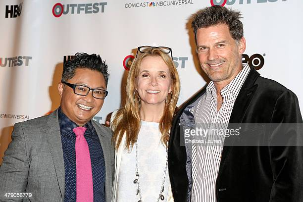 Fusion Achievement Award winner Alec Mapa actress Lea Thompson and actor DW Moffett arrive at the Outfest 2014 fusion LGBT People of Color film...