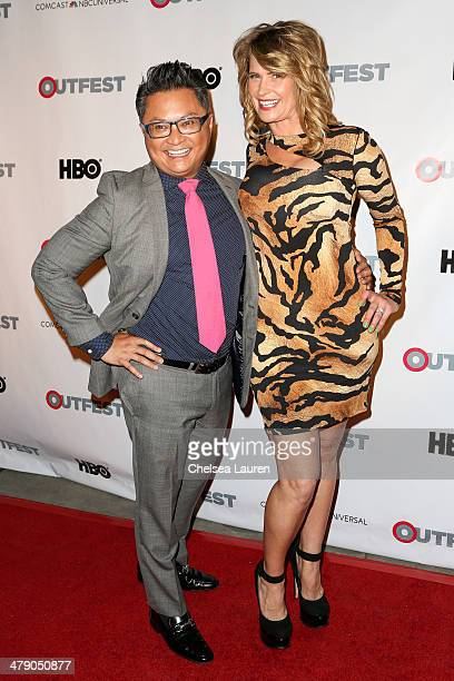 Fusion Achievement Award winner Alec Mapa and actress Kristy Swanson arrive at the Outfest 2014 fusion LGBT People of Color film festival gala at the...