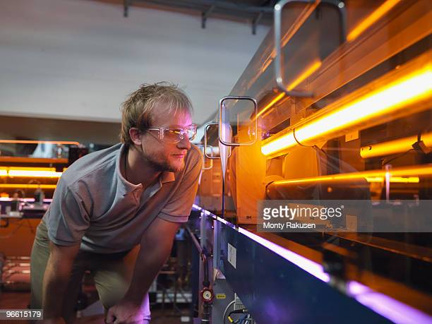fusion reactor scientist with laser - atomic imagery imagens e fotografias de stock