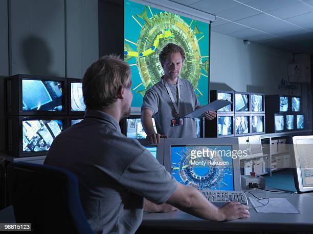 fusion reactor scientists at work - nuclear fusion stock pictures, royalty-free photos & images