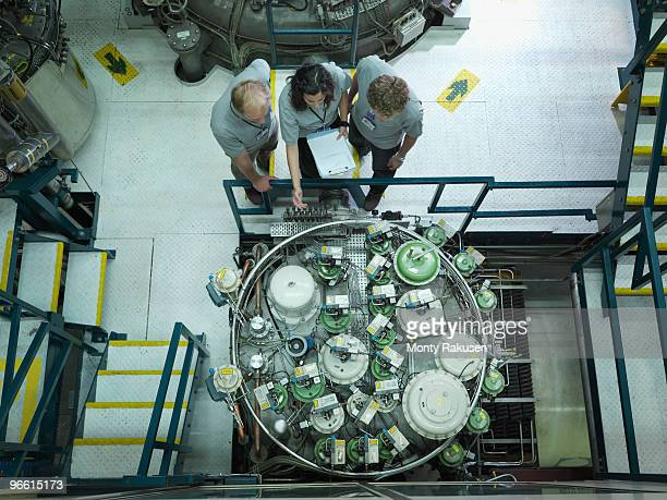 fusion reactor scientists at work - nuclear reactor stock pictures, royalty-free photos & images