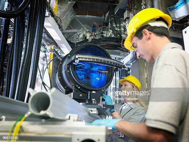fusion reactor scientists with lens - nuclear reactor stock pictures, royalty-free photos & images