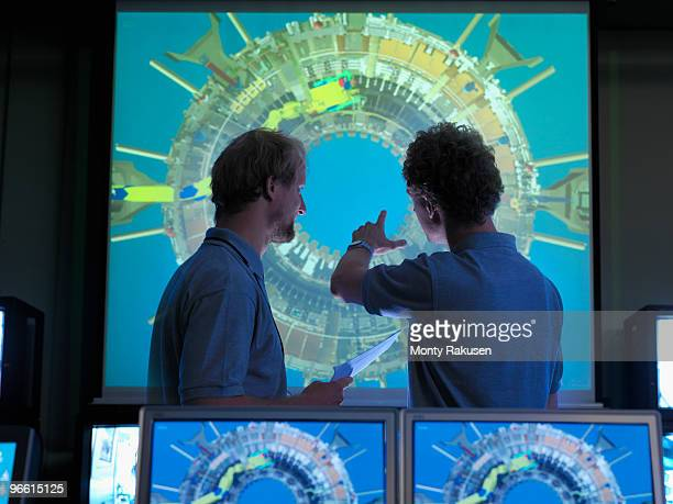 Fusion Reactor Scientists With Screens