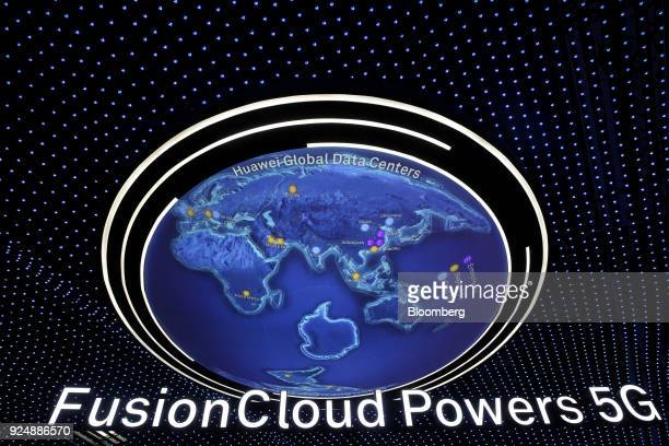 A FusionCloud 5G illuminated sign hangs from the ceiling at the Huawei Technologies Co pavilion during day two of the Mobile World Congress in...