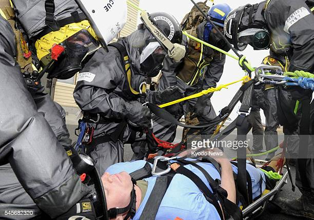Fussa Japan Members of the US Marine Chemical Biological Incident Response Force take part in a drill at Yokota Air Base in Tokyo on April 9 assuming...