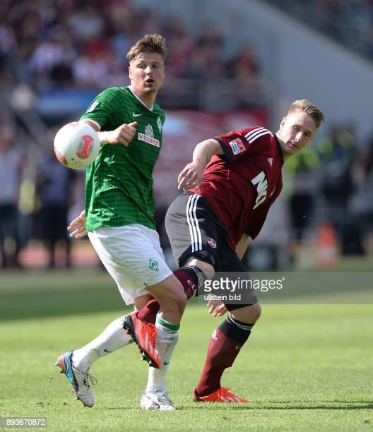 Fussball 1 Bundesliga Saison 2012/2013 34 Spieltag Nuernberg SV Werder Bremen Sebastian Proedl gegen Sebastian Polter