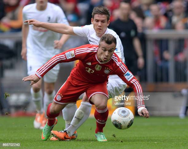 Fussball 1 Bundesliga Saison 2013/2014 21 Spieltag FC Bayern Muenchen SC Freiburg Xherdan Shaqiri gegen Oliver Sorg