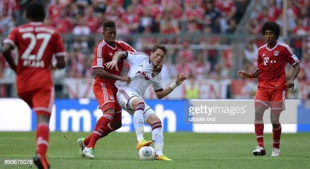Fussball 1 Bundesliga Saison 2013/2014 3 Spieltag FC Bayern Muenchen 1 FC Nuernberg Jerome Boateng gegen Daniel Ginczek und Dante