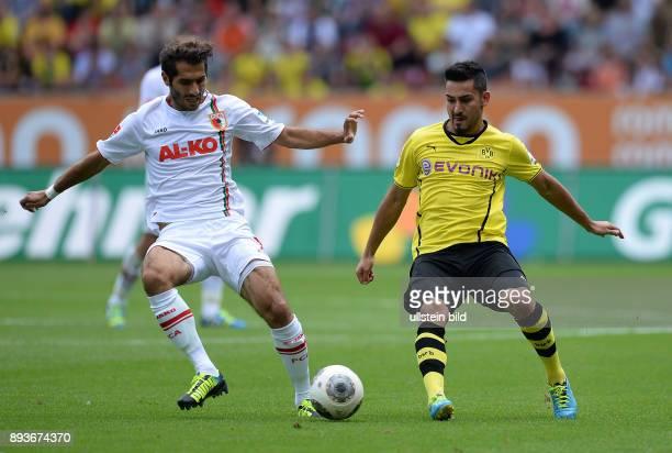 Fussball 1 Bundesliga Saison 2013/2014 FC Augsburg Borussia Dortmund Halil Altintop gegen Ilkay Guendogan