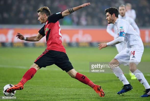 Fussball 1 Bundesliga Saison 2016/2017 20 Spieltag SC Freiburg 1 FC Koeln Maximilian Philipp gegen Jonas Hector