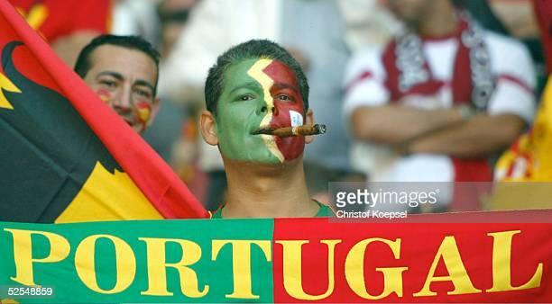 Fan mit Zigarre / POR 20.06.04.