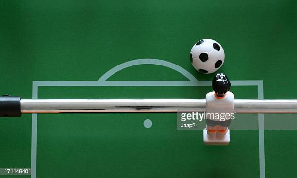 Fussball goalkeeper ready to kick the ball, seen from above