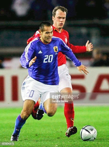 Naohiro TAKAHARA / JPN . Fabian ERNST / GER 16.12.04.