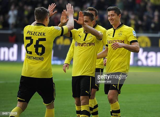 Fussball, Saison 2012-2013, 1. Bundesliga, 30. Spieltag, Borussia Dortmund - FSV Mainz 05, v.li., feiern Lukasz Piszczek , Moritz Leitner und Robert...