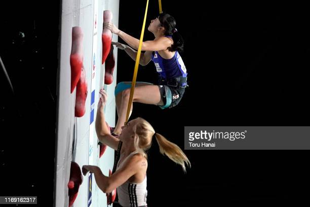 Futaba Ito of Japan and Janja Garnbret of Slovenia compete in the Speed during Combined Women's Final on day ten of the IFSC Climbing World...