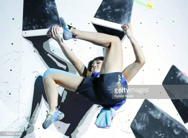 Futaba Ito of Japan competes in the bouldering discipline of the women's combined final at the sport climbing world championships in Hachioji, Tokyo,...