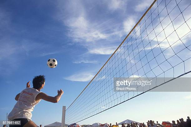 Futevolei the beach volleyball game played using only feet chest and head to hit the ball Ipanema beach Rio de Janeiro