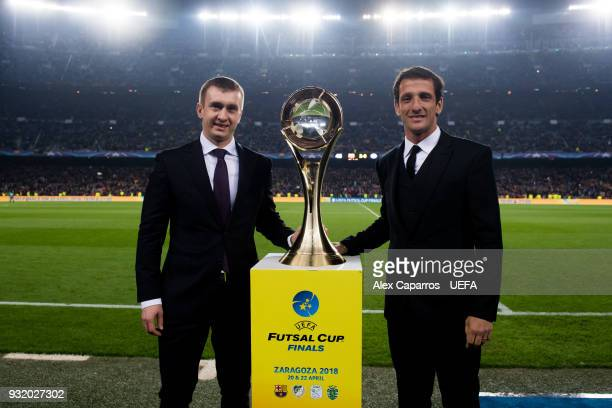 Futsal Beach Soccer Committee Aleksandr Alaev and Juliano Belletti pose with the trophy after the UEFA Futsal Cup Finals Zaragoza 2018 draw during...