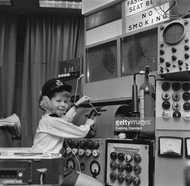 Future actor Gary Oldman pretends to be a pilot at a home-made control panel, UK, December 1967.