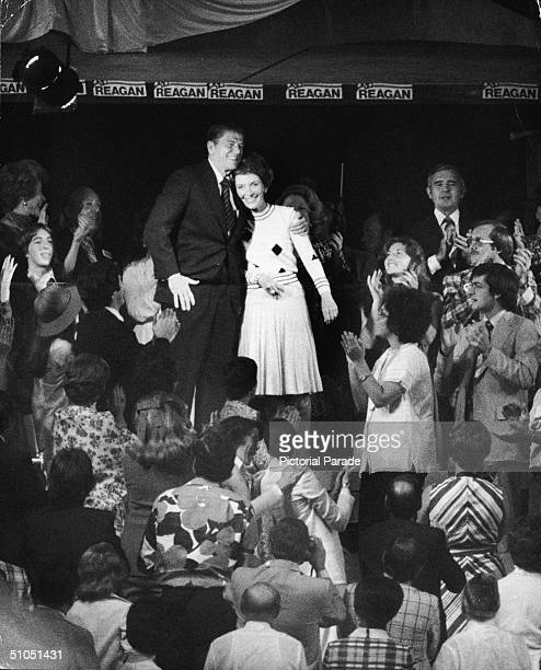 Future American president Ronald Reagan hugs his wife Nancy Reagan while conventioneers applaud as the pair make their way to the podium during the...