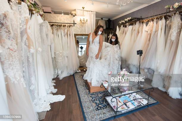 Future Bride, Sharni wears a face mask as she tries on wedding dresses in Blush bridal boutique on July 4, 2020 in Leigh-on-Sea, England. Wedding...