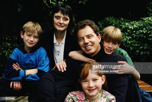 Future British Prime Minister Tony Blair photographed in his garden with his wife Cherie and their children Euan Nicky and Kathryn
