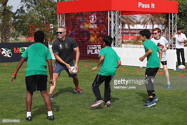 Future Falcons play touch rugby in the Championship Village with Ex Internation rugby player Christian Cullen during day one of the Abu Dhabi HSBC...