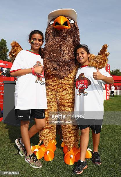 Future Falcons pose with the 'Future Falcon' mascot during day one of the Abu Dhabi HSBC Championship at Abu Dhabi Golf Club on January 19 2017 in...