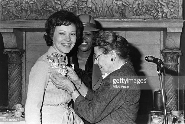 Future First Lady Rosalynn Carter smiles as she accepts a corsage during an event in support of her husband, Jimmy Carter's presidential campaign,...